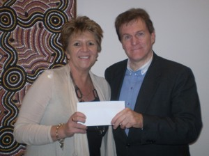 Hetty Johnson, Executive Director Bravehearts, accepts cheque for one thousand dollars from MAIA President Walt Missingham
